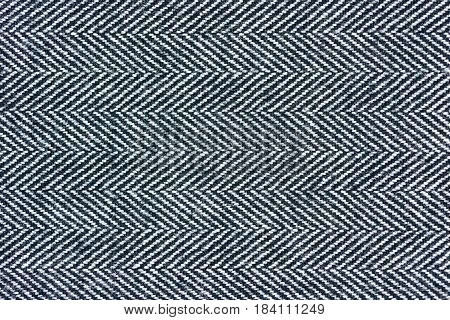 Detailed Close-Up of a gray herringbone fabric pattern for background purposes