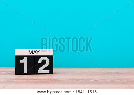 May 12th. Day 12 of month, calendar on turquoise background. Spring time, empty space for text. International Nurses Day.