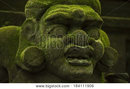 Statues and carvings depicting demons, gods and Balinese mythological deities. God of monkeys. Monkey Forest, Ubud, Bali