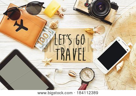 Travel. Let's Go Travel Text Sign Concept On Card Flat Lay, Camera Sunglasses Compass Passport Money