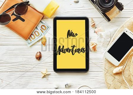 New Adventure Text Sign Concept On Yellow Tablet Screen. Say Yes To New Adventures. Summer Travel Pl