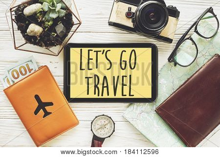 Travel. Let's Go Travel Text Sign Concept On Tablet With Yellow Screen, Money Map Compass Camera Gla
