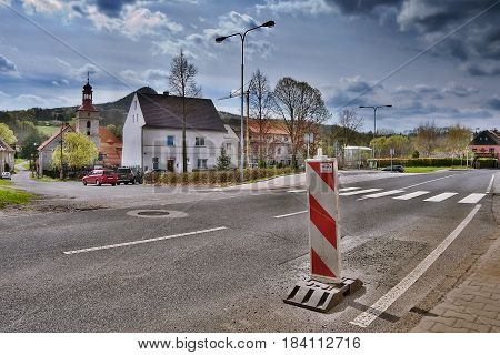 Stvolinky Machuv kraj Czech republic - April 14 2017: route 15 with traffic sign leading around green square in spring afternoon