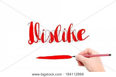 The word of Dislike written by hand on a white background