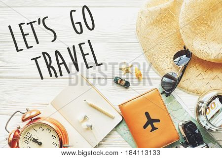 Travel. Let's Go Travel Text Sign Concept, Wanderlust. Map Camera Passport Money Sunglasses And Cloc