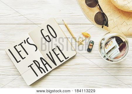 Travel. Let's Go Travel Text Sign Concept On Empty Notebook. Planning Summer Travel Concept And Wand