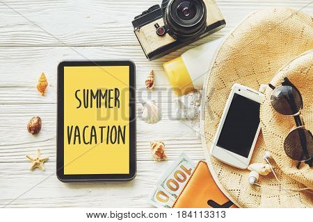 Summer Vacation Text Sign On Yellow Tablet Screen. Planning Summer Holiday Flat Lay, Camera Sunglass