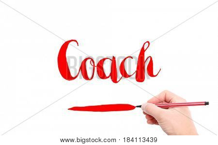 The word of Coach written by hand on a white background