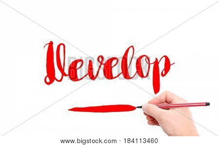 The word of Develop written by hand on a white background