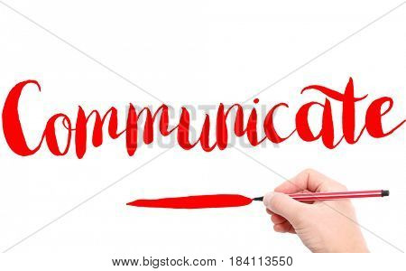 The word of Communicate written by hand on a white background