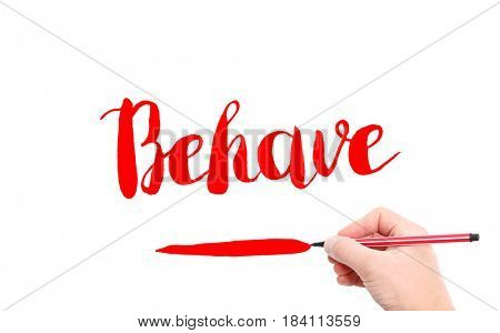 The word of Behave written by hand on a white background