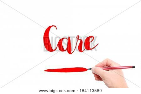 The word of Care written by hand on a white background
