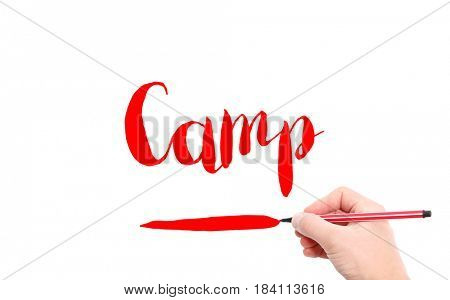 The word of Camp written by hand on a white background