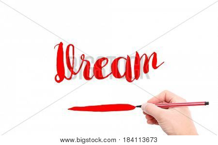 The word of Dream written by hand on a white background