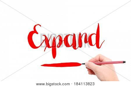 The word of Expand written by hand on a white background