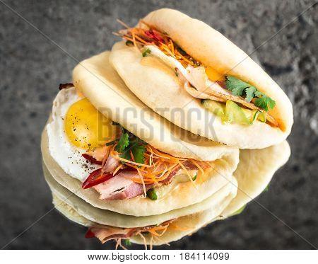 Bao bun steamed sandwich with fried egg and bacon, gua bao