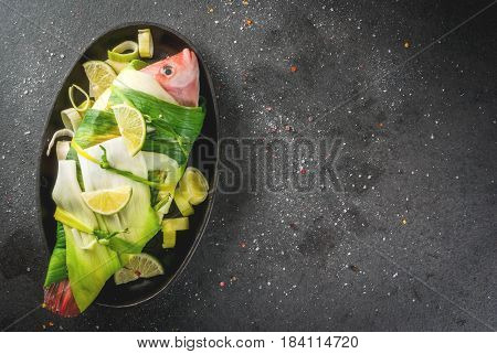Raw Fish Red Tilapia Wrapped In Leek