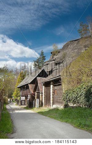 large rock above cottages in village Karba in tourist area Machuv kraj of spring czech landscape