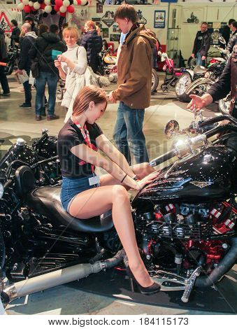 St. Petersburg Russia - 15 April, The girl in the tricycle chair,15 April, 2017. International Motor Show IMIS-2017 in Expoforurum. Models on motorcycles presented at the motor show.