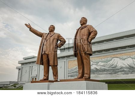 PYONGYANG, NORTH KOREA, - JULY 29, 2014: Bronze statue of Kim Il Sung and Kim Jong Il on the Mansu hill.