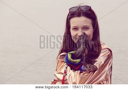 girl with dog in the outdoor. photo