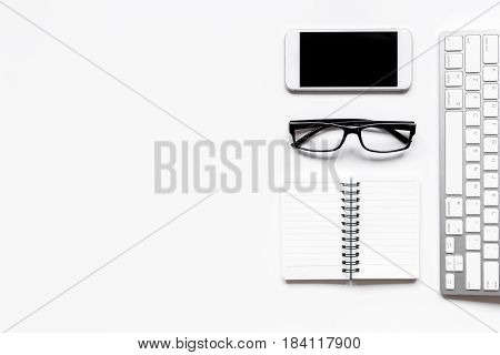 office flat lay table with keyboard, phone, notebook on white background top view mockup