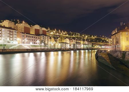 View Of The City Of Bilbao At Night.
