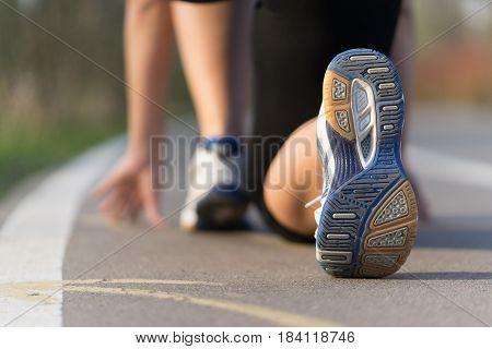 closeup woman runner shoe on park trail