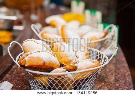 Close Up Baskets With Freshly Baked Pastry Goods On Display In Bakery Shop. Selective Focus