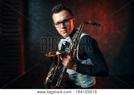 Male saxophonist with saxophone, jazz man with sax