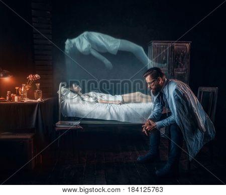 Worried man against dead woman, soul left body