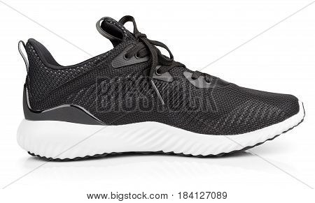 Single new unbranded black sport running shoe sneakers or trainers isolated on white background with clipping path