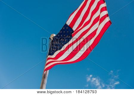 American Flag waiving outside on a street