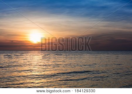 beautiful sunset over the tranquil ocean
