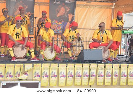 LE MANS FRANCE - APRIL 22 2017: Festival Evropa jazz Musicians dress with costumes and playing drums Caribbean music