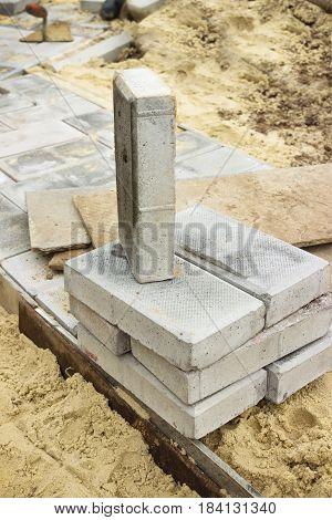 Path of concrete cobblestone in the process of construction