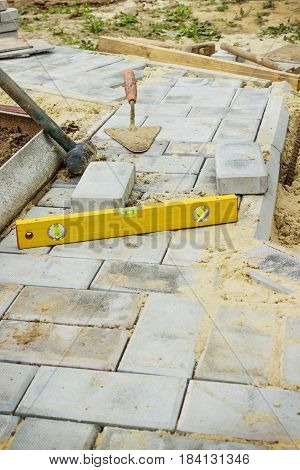 Path of concrete cobbles in the process of construction