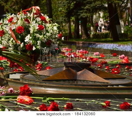 Eternal flame memorial to fallen defenders with carnations around