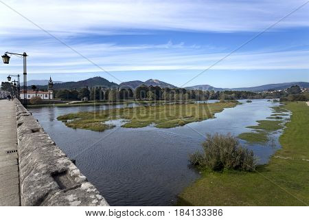 View of the Limia River seen from the medieval bridge in Ponte de Lima Portugal
