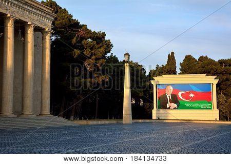 SUMGAIT, AZERBAIJAN - 17 JAN 2014 Heydar Aliyev in front of Azerbaijani flag on poster. Photograph of former President of Azerbaijan displayed in City Square, in town north of Baku