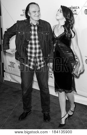 NEW YORK NY - APRIL 28 2017: Director Quentin Tarantino and Daniella Pick attend the 'Reservoir Dogs' 25th Anniversary Screening during 2017 Tribeca Film Festival at The Beacon Theatre