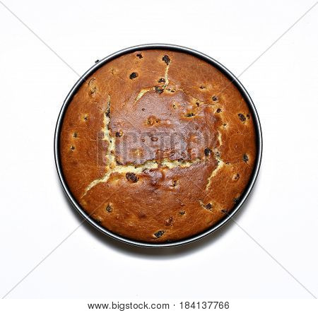 Easter cake baked with raisins in the form for baking isolated on white background