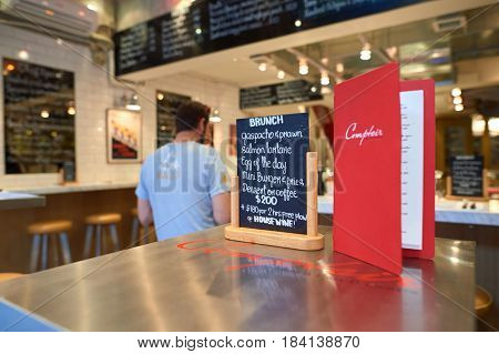 HONG KONG - OCTOBER 25, 2015: menu on a table at cafe in Kennedy Town. Kennedy Town is at the western end of Sai Wan on Hong Kong Island
