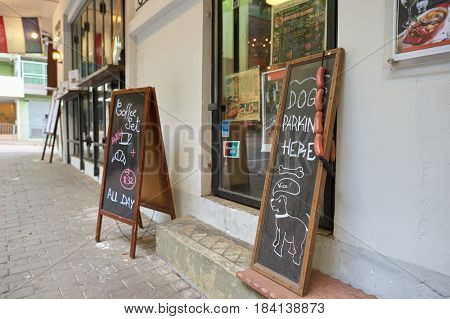 HONG KONG - OCTOBER 25, 2015: chalkboard sign outside in Kennedy Town. Kennedy Town is at the western end of Sai Wan on Hong Kong Island