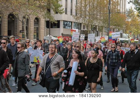 Adelaide, AU - May 12, 2012: Supporters and opponents of Marriage Equality march to the centre of Rundle Mall's shopping precinct for the South Australian Equal Rights rally.