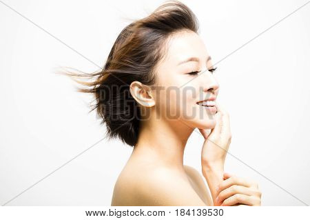 side view of smiling Woman with hair motion