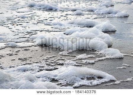 Sea Foam on the sandy beaches of the Atlantic coast.