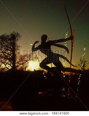 Sunset Goddess Firing Arrow into the night!