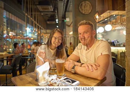 HONG KONG - OCTOBER 25, 2015: indoor portrait of two people at Kennedy Town. Kennedy Town is at the western end of Sai Wan on Hong Kong Island