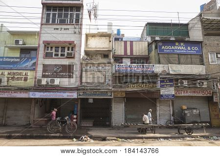 DELHI INDIA - JUN 10 : morning city scene on street in chandni chowk in old delhi on june 10 2015 india. usually all shops of old delhi open at noon time